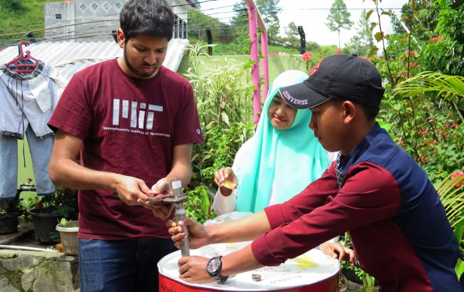 Sami Khan (G) (left) made a biodigester with help from the orphanage staff, and designed and built a sustainable vegetable garden in Takengon, Indonesia.