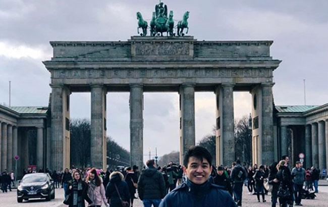 A study abroad student at the Brandenburg Gates in Berlin, Germany.